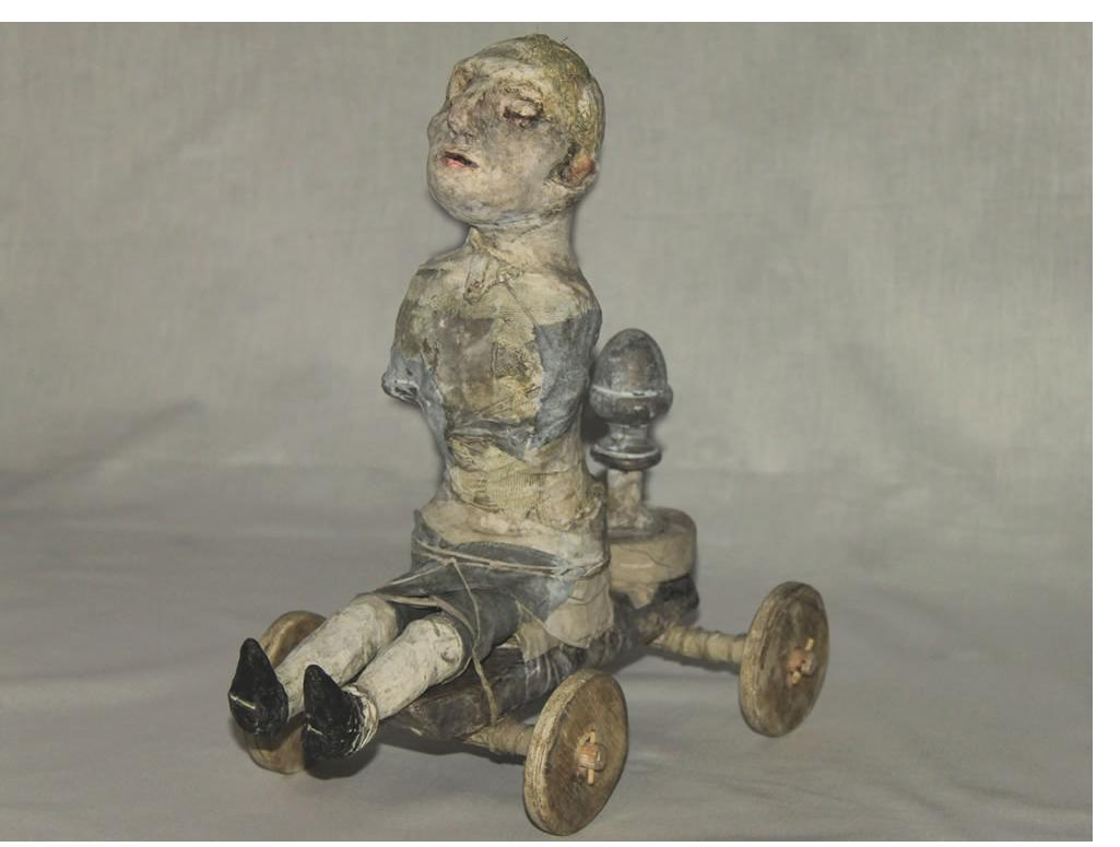 Stroff Denis :'The ride' 2011 Wood papier-mâché acryl paint mixed  media H 29cm x L 17cm x D 27cm